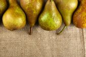 Ripe pears on sackcloth background — Stock Photo