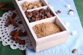 Wooden box with set of coffee and cocoa beans, sugar cubes on wooden background — Stock Photo
