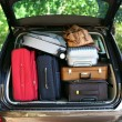 Suitcases and bags in trunk of car ready to depart for holidays — Stock Photo #54198203