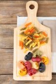 Colorful pasta on wooden background — Stock Photo