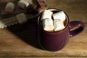 Hot chocolate with marshmallows in mug, on wooden background — Stock Photo