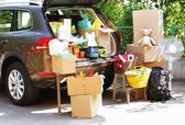 Moving boxes and suitcases in trunk of car, outdoors — ストック写真