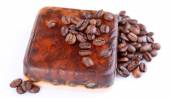 Organic soap with coffee beans, isolated on white — Stock Photo