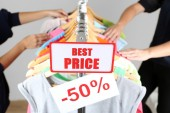 Fashion clothes on shelves in store. Shopping concept — Stockfoto