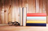 Books on wooden table — Stockfoto