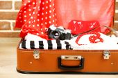 Female clothes in old suitcase — Stock Photo