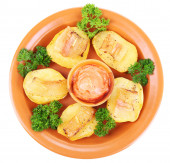 Baked potato with bacon on plate — Stock Photo