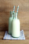 Retro bottles of tasty rustic milk — Stock Photo