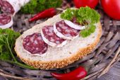 French salami with tomatoes, bread and parsley — Stock Photo
