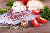 French salami with tomatoes, parsley and bread — Stock Photo