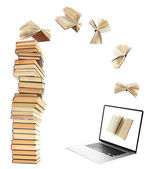 Books flying in tablet — Stock Photo