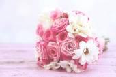 Beautiful wedding bouquet on table on light background — Stock Photo