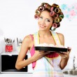 Beautiful girl in hair curlers in kitchen — Stock Photo #54285957
