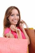 Beautiful young woman with shopping bags isolated on white — Stok fotoğraf