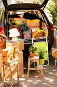 Moving boxes and suitcases in trunk of car — Stock Photo