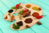 Painting palette with various spices and herbs, on color wooden background — Stock Photo