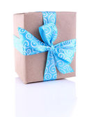 Holiday gift box decorated with blue ribbon isolated on white — 图库照片