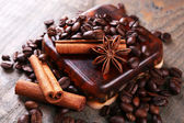 Organic soap with coffee beans and spices on wooden background — Stock Photo