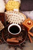 Cup with coffee drink, soap with coffee beans and spices, sponge and massage brush on wooden background. Coffee spa concept — Stock Photo