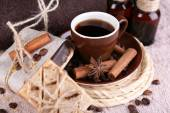 Cup with coffee drink, soap with coffee beans and spa treatment on dark background. Coffee spa concept — Stock Photo