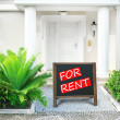 Real estate sign in front of new house for rent — Stock Photo #54443553