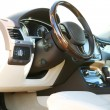 Interior view of car with beige salon and black dashboard — Stock Photo #54512073
