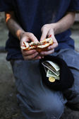 Homeless beggar food and money  — Stock Photo
