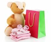 детская одежда и подарок сумка изолированные на белом — Стоковое фото