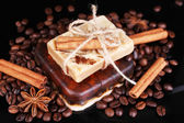 Organic soap with coffee beans and spices, on dark background — Stock Photo