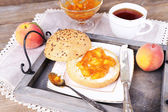 Light breakfast with cup of tea and homemade jam on wooden table — Stock Photo