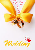 Wedding rings tied with ribbon — Stock Photo