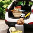 Suitcases and bags in trunk of car ready to depart for holidays — Stock Photo #54624923