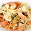 Fresh prawns with coloured macaroni closeup — Stock Photo #54630193