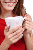 Beautiful young girl with cup of coffee close-up — Stock Photo