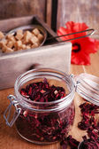 Dried hibiscus tea in glass jar — Stock Photo