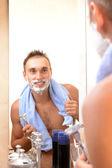 Young man shaving — Stock Photo