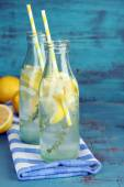 Tasty cool beverage with lemon — Stock Photo