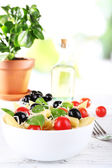 Pasta with tomatoes, olives and basil leaves — Stock Photo