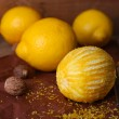 Lemons, nutmegs and grater — Stock Photo #54845655