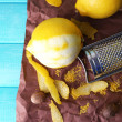 Lemons, nutmegs and grater — Stock Photo #54845715