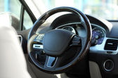 Interior view of car with beige salon and black dashboard — Stock Photo
