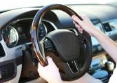 Man's hands on a steering wheel — Stock Photo
