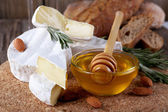 Camembert cheese, nuts, honey and bread — Stock Photo