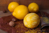 Lemons, nutmegs and grater — Stock Photo