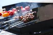 Sausages and vegetables on barbecue — Stockfoto