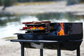 Sausages and vegetables on barbecue — Stock Photo