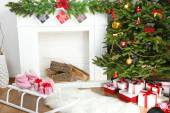 Fireplace with beautiful Christmas decorations in room — Stock fotografie