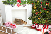 Fireplace with beautiful Christmas decorations in room — Stok fotoğraf