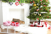Fireplace with beautiful Christmas decorations in room — Stockfoto
