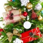 Gift boxes on Christmas tree closeup — Stock Photo #54851247